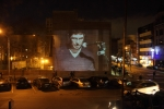 Joshua Furst projected on the wall across the street